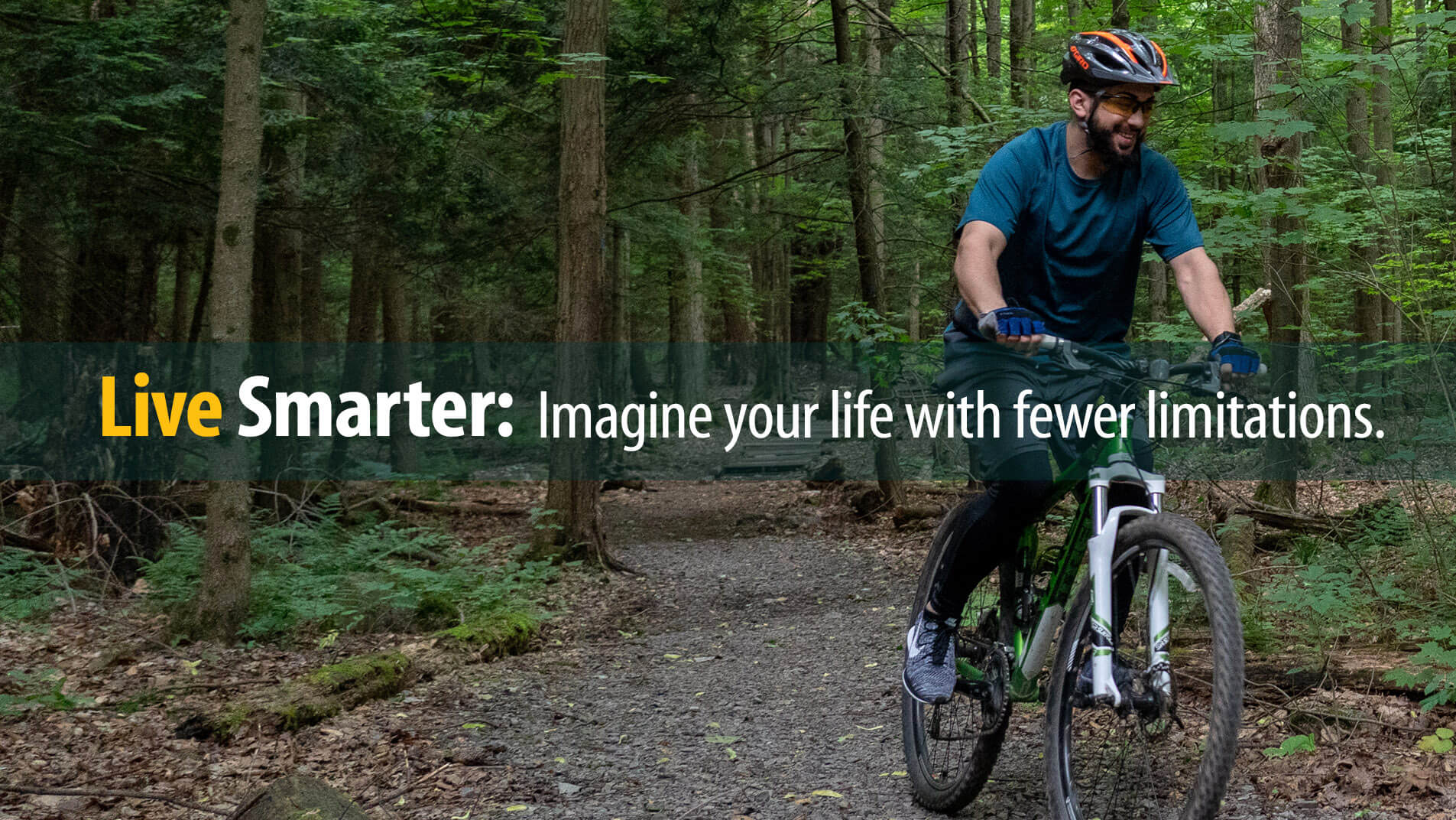 Smiling man riding mountain bike on forest trail enjoys life with fewer limitations of debt
